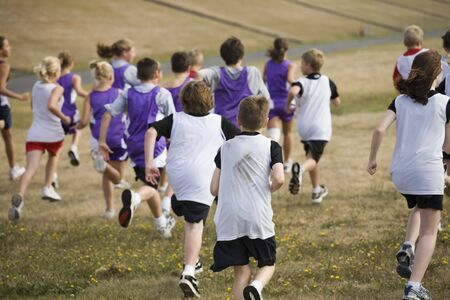heathy: Photo of two teams of cross country runners at the start of a race. Stock Photo