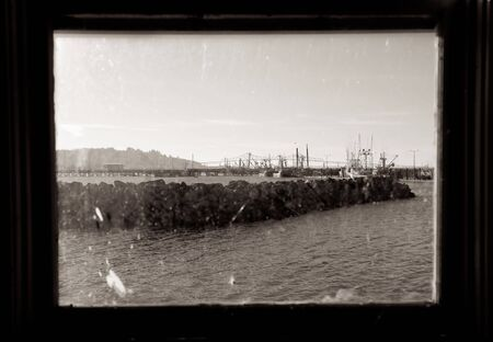 Photo of the East Mooring Basin in Astoria, Oregon. Taken from an abandonned net shed overlooking the Columbia River. photo