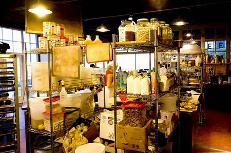 store shelf: Photo of an interior of a combination coffee shop and bakery. Stock Photo