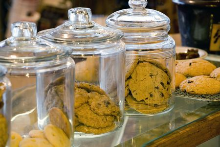 Photo of glass cookie jars in a combination coffee shop and bakery.