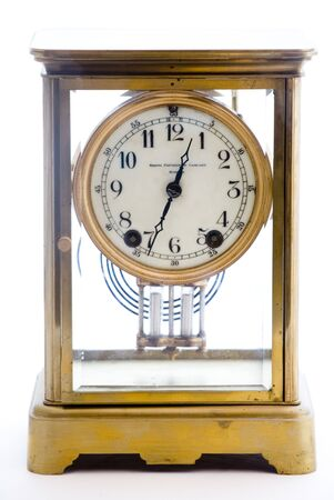 Photo of an antique glass clock on a white background. The clock is copyright 1897 and I own it.