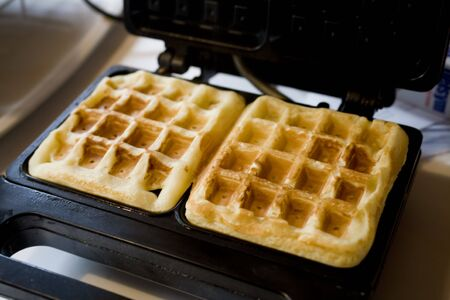 Photo of two Belgian waffles in a wafflemaker