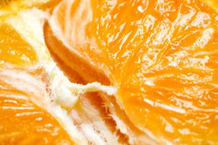 Photo of a very juicy sliced orange.
