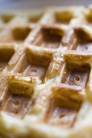 Photo of a Belgian waffle shot up close with a macro lens. photo