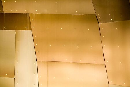 Abstract view of a metal building with various metallic colors. photo