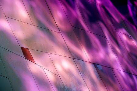 Abstract view of a metal buildiing with various metallic colors. photo
