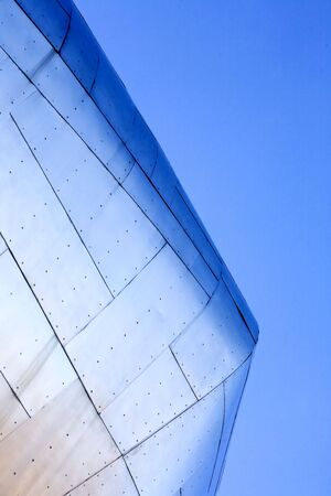 Abstract view of a metal buildiing against blue sky. photo