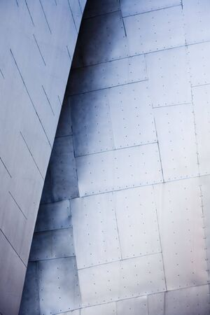 Abstract view of a metal buildiing with various metallic shapes. photo
