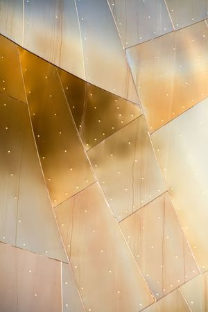 Abstract view of a metal building with various metallic colors. Stock Photo