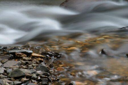 rushing water: Photo of rushing water and rocks.