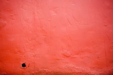 avant garde: Red hull of a fishing boat suitable for a red background. Stock Photo