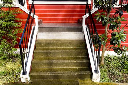 duplex: Photo of stairs leading to an attractive red duplex. Stock Photo