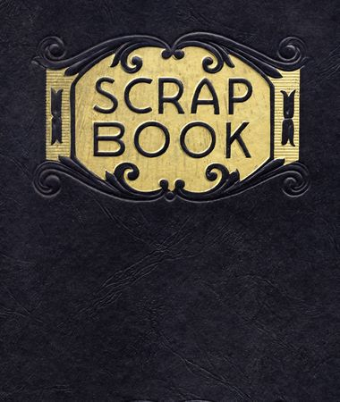 Antique scrapbook, circa 1890, with black cover and gold leaf printing.