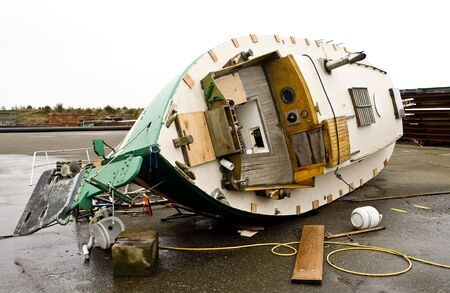 high winds: Photo of a boat in drydock that was knocked over by hurricane force winds in Astoria, Oregon. Stock Photo