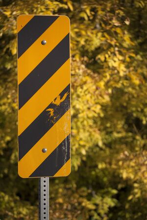 Yellow and Black Caution Sign on the Railing of a Bridge Stock Photo - 16762992