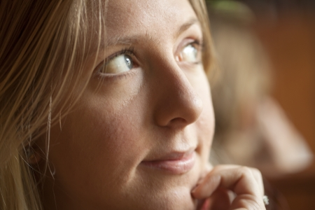 blonde  blue eyes: Young woman looking off to the side contemplating the future.