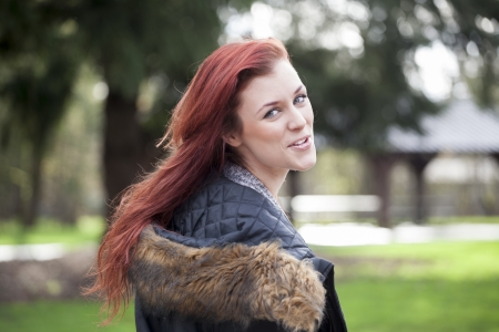 auburn hair: Young woman staring straight ahead into the camera