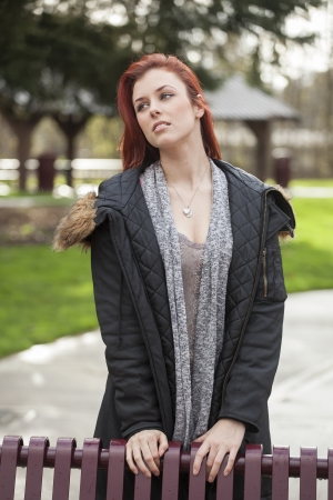 auburn: Young woman with green eyes staring off into the distance.
