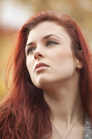 auburn hair: Young woman staring off away from the camera Stock Photo