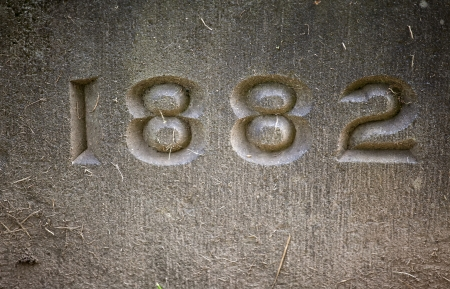 The number 1882 carved in stone.