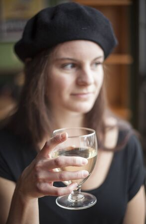 pinot grigio: Portrait of a young woman with white wine.