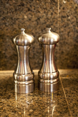 counter top: Salt and pepper shakers on a granite counter top