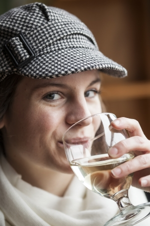 pinot grigio: Portrait of a young woman with white wine