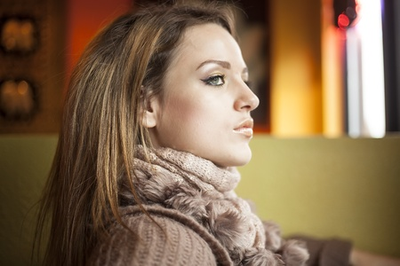 light brown eyes: Portrait of a young woman looking away from the camera