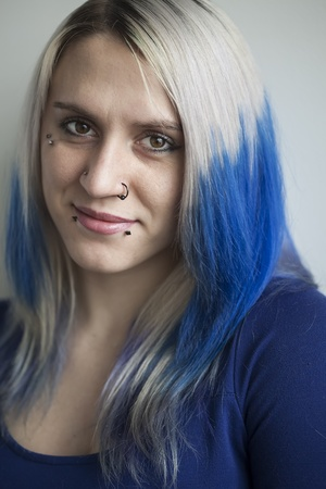Portrait of a beautiful young woman with blue hair. Stock Photo - 18426889