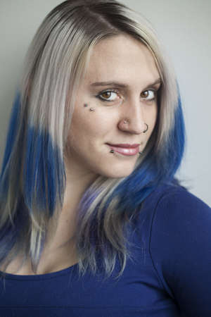 Portrait of a beautiful young woman with blue hair. Stock Photo - 18426894