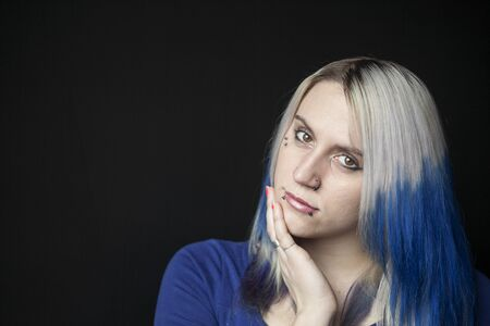 Portrait of a beautiful young woman with blue hair shot on a black background. Stock Photo - 18426891