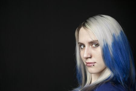 Portrait of a beautiful young woman with blue hair shot on a black background. Stock Photo - 18426892