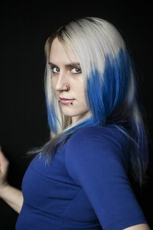Portrait of a beautiful young woman with blue hair shot on a black background. Stock Photo - 18426893
