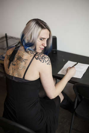 goth girl: A beautiful, alternative goth girl fills out a job application  Stock Photo