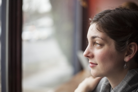 introspective: Portrait of a young woman looking away from the camera