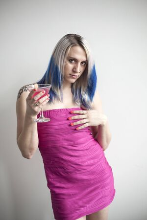 gass: Portrait of a beautiful young woman with blue hair and a very short pink dress holding a pink martini.