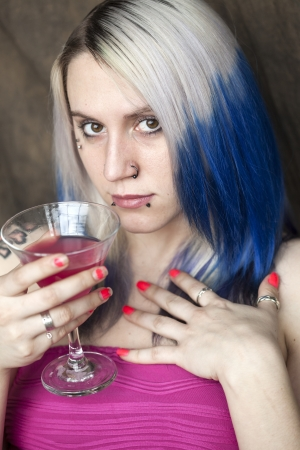 gass: Portrait of a beautiful young woman with blue hair and pink dress holding a pink martini.