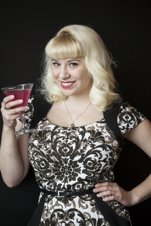 bleached: Portrait of a beautiful young woman with blond hair drinkiing a pink martini.