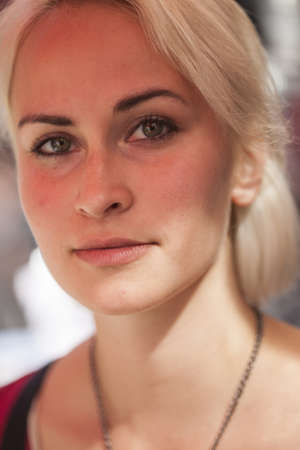 soulful eyes: Portrait of a beautiful blond woman shot outdoors. She has green eyes and bleached blond hair. Stock Photo