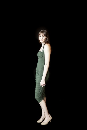 dark brown hair: Beautiful young woman with dark brown hair and eyes against a black background.
