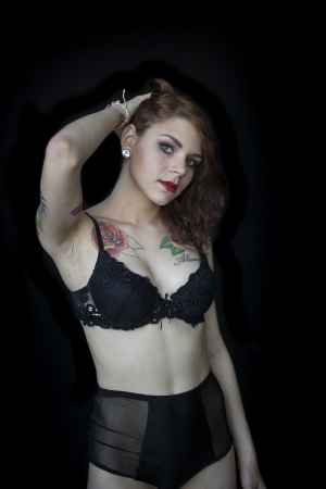 eye tattoo: Portrait of a beautiful young woman in a black bra and panties. Stock Photo