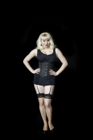 nylons: Portrait of a beautiful young woman with blond hair and brown eyes shot in a black corset. Stock Photo