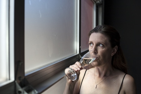 Portrait of a beautiful woman in a black dress with Champagne. photo