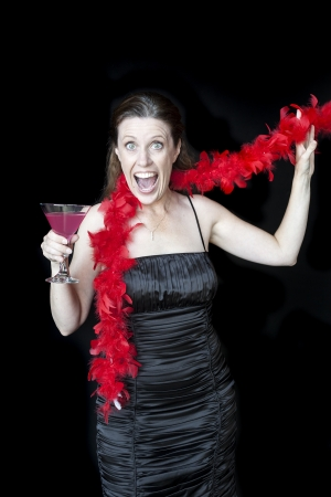 beautiful middle aged woman: Portrait of a beautiful woman in a black dress with pink martini and red boa.