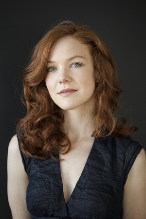 auburn hair: Portrait of a beautiful young woman with red hair and blue eyes.
