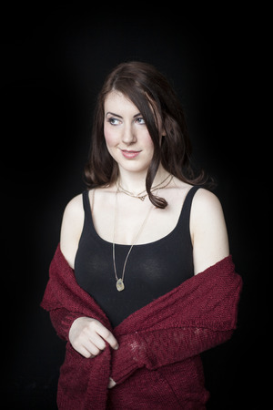 dark eyes: Beautiful smirking woman with dark brown hair and blue eyes. Stock Photo