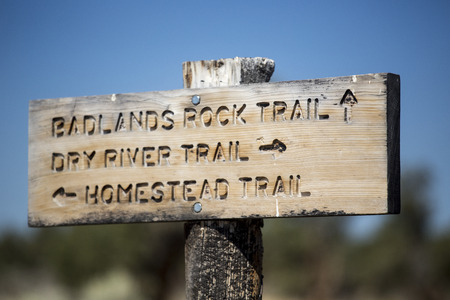 trails: A wooden trail sign at the Oregon Badlands Wilderness Area