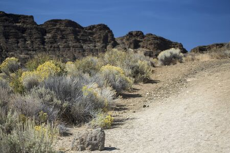 state of oregon: Hiking Trail at Fort Rock State Park in Central Oregon.