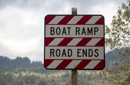 the ends: Sign announcing the obvious: Boat Ramp, Road Ends Stock Photo