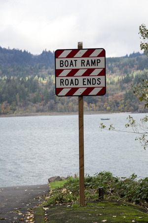 Sign announcing the obvious: Boat Ramp, Road Ends Stock Photo